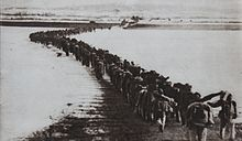 Chinese troops crossing into Korea during the war