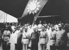 Generals of the KMT army at the commencement of the Northern Expedition with the KMT flag in the background